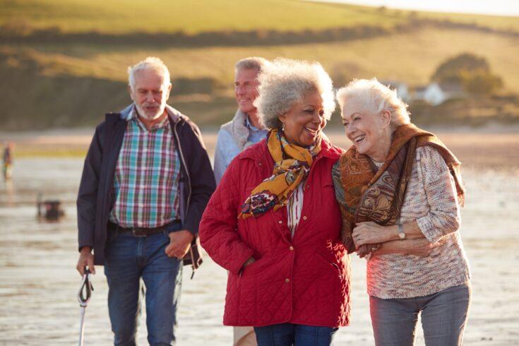 Older people walking on beach