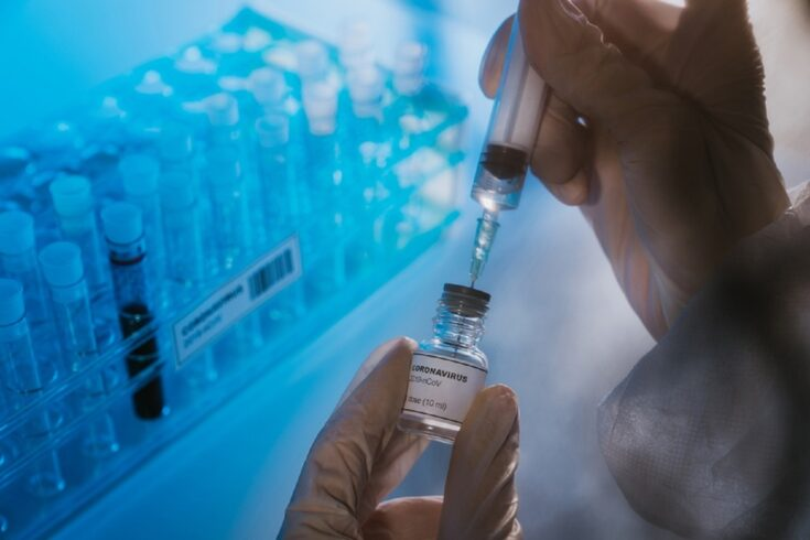A coronavirus vaccine (front), testing tubes (back)