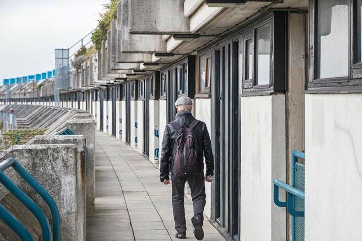 Man walking along housing estate