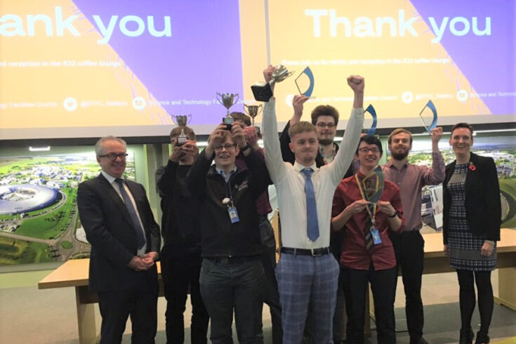 Apprentices celebrate at STFC's own apprenticeship awards in 2019 at the Rutherford Appleton Laboratory. They are joined by Mark Thomson, STFC Executive Chair (far left) and Helen Johnson, Head of Apprenticeships (far right).