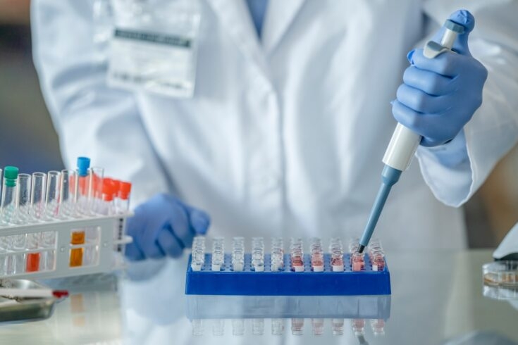 Researcher working in a scientific laboratory searching for a vaccine for COVID-19