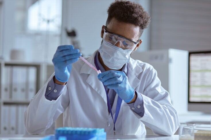 Young scientist working with samples in a laboratory