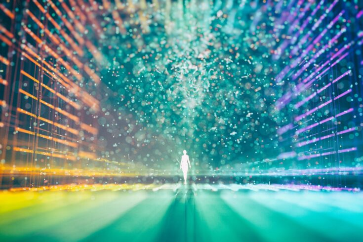 Abstract multicolored grid and a glowing figure surrounded by particles in the centre