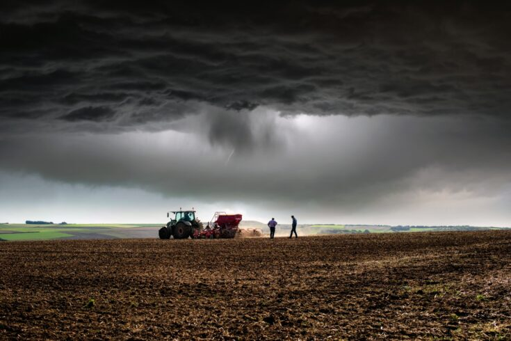 Farmer at work under storm