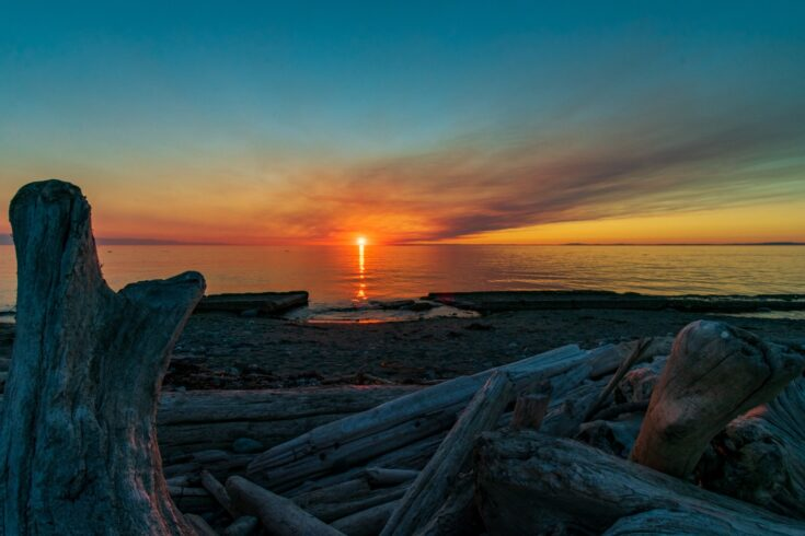 Whidbey Island sunset is extra orange due to wildfire smoke