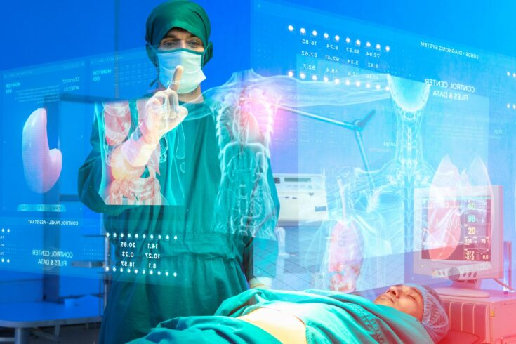 Surgeon doctors and patients in surgery operation room futuristic high technology. AR augmented reality surgery technology body organ analyze x-ray scan data information on digital monitor screen.