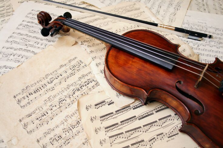 Violin with bow and music sheet