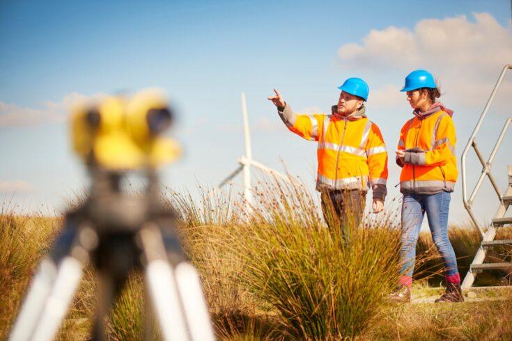 Male and female windfarm engineers