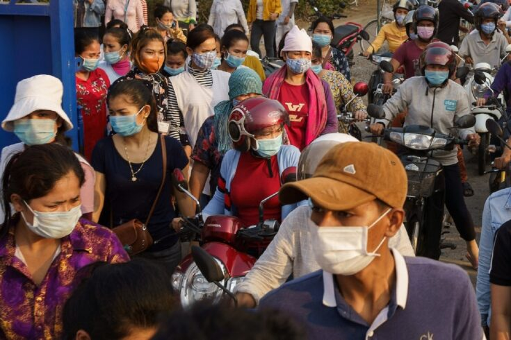 hnom Penh (Cambodia). Workers leave Quantum Clothing Cambodia after been laid off due to lack of demand caused by COVID-19.