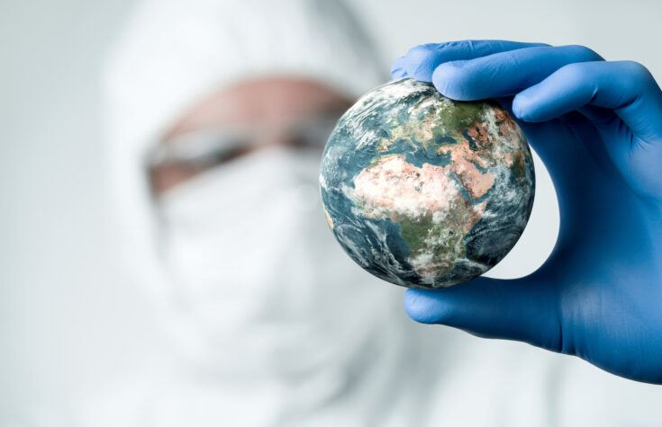 Man holding globe of Earth in hand