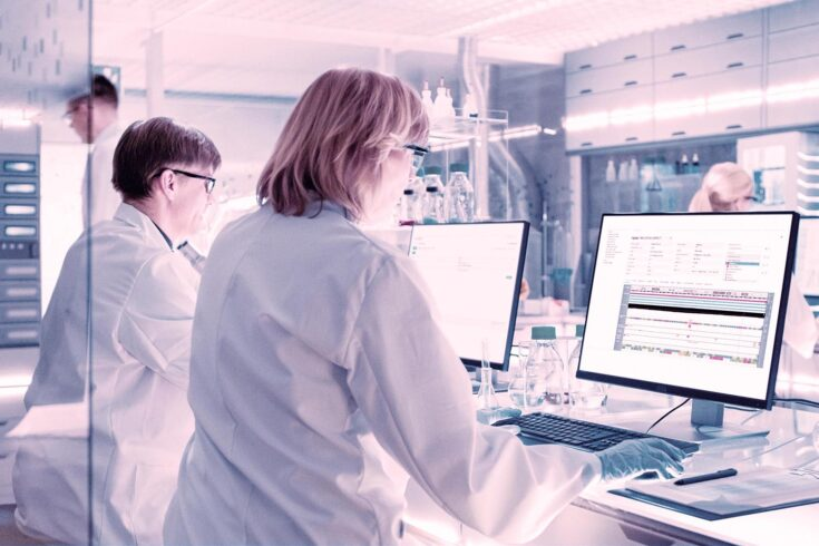 Scientists in diagnostic laboratory using Congenica to solve rare disease cases