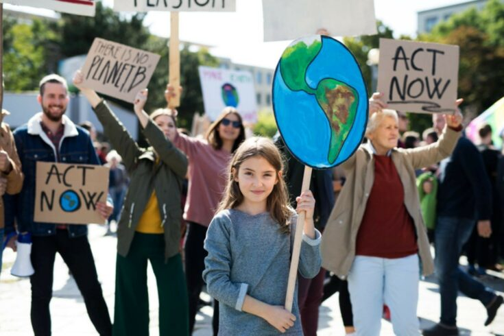 People with placards and posters on a global strike for climate change