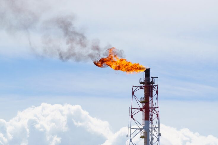 Fire torching against the sky, burning gas flaring