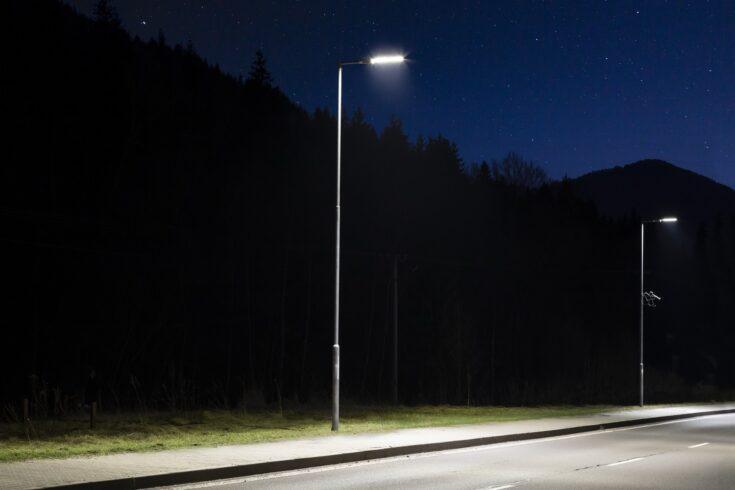 Two modern streetlights, LED, empty road