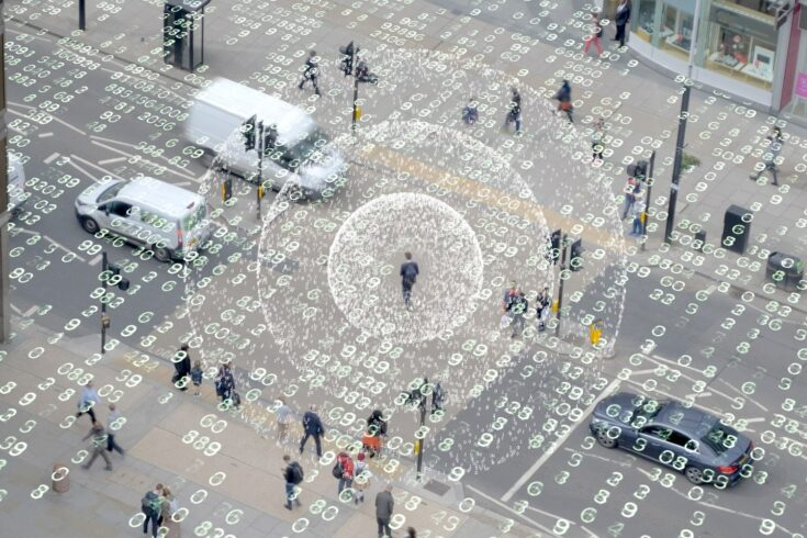 Aerial view of a street with data surrounding people