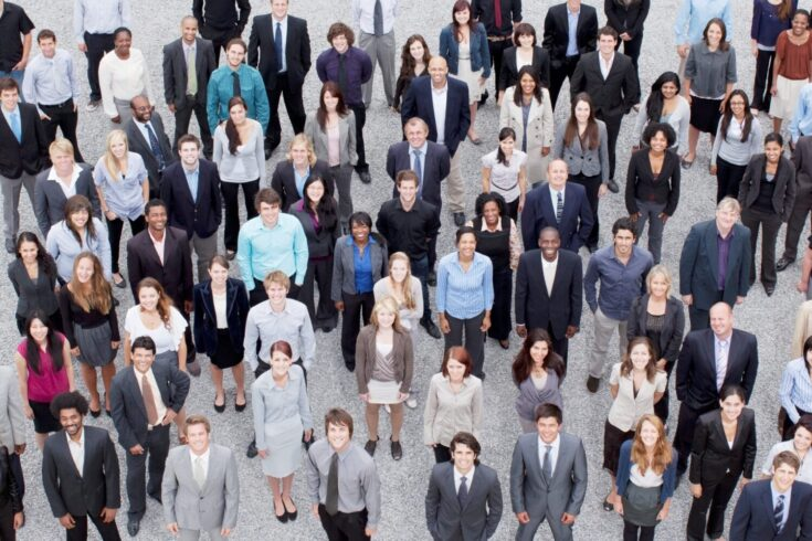 Portrait of business people in crowd